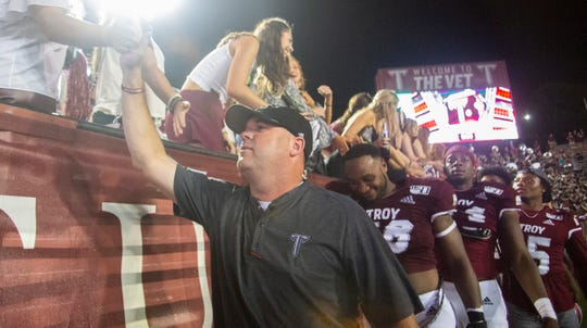 Troy's head coach Chip Lindsey thanks fans for sticking it out through the rain to watch the Trojans defeat the Camels 43-14.