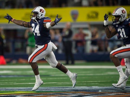 Auburn defensive back Daniel Thomas (24) celebrates a big defensive stop in the fourth quarter at AT&T Stadium in Arlington, Texas, on Saturday, Aug. 31, 2019. Auburn defeated Oregon 27-21.