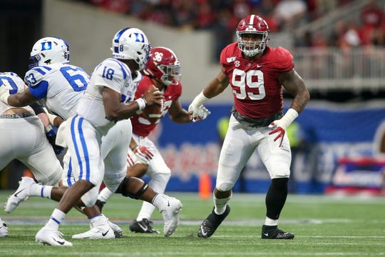 Aug 31, 2019; Atlanta, GA, USA; Alabama Crimson Tide defensive lineman Raekwon Davis (99) rushes Duke Blue Devils quarterback Quentin Harris (18) in the fourth quarter at Mercedes-Benz Stadium. Mandatory Credit: Brett Davis-USA TODAY Sports