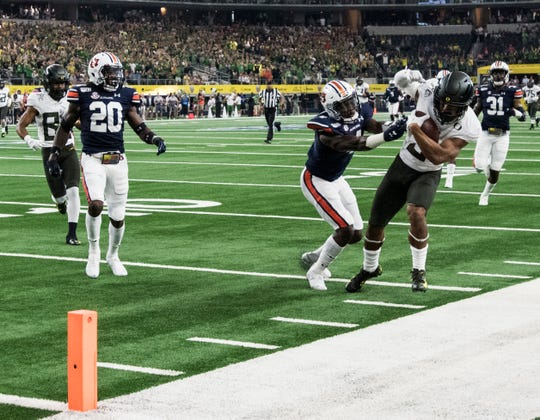 Auburn defensive back Noah Igbinoghene (4) pushes Oregon wide receiver Johnny Johnson III (3) out of bounds at AT&T Stadium in Arlington, Texas, on Saturday, Aug. 31, 2019.