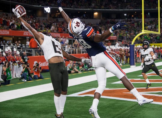 Oregon defensive back Deommodore Lenoir (6) drops a pass intended for Auburn wide receiver Seth Williams (18) at AT&T Stadium in Arlington, Texas, on Saturday, Aug. 31, 2019.