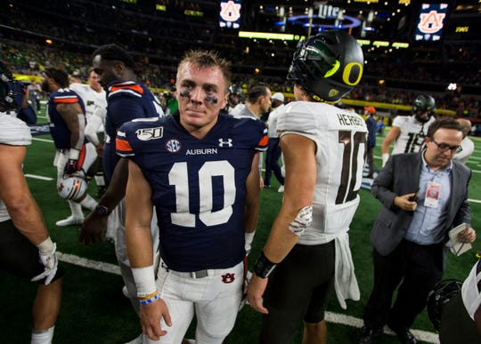 Auburn quarterback Bo Nix (10) shakes hands with Oregon quarterback Justin Herbert (10) after the game at AT&T Stadium in Arlington, Texas, on Saturday, Aug. 31, 2019. Auburn defeated Oregon 27-21.