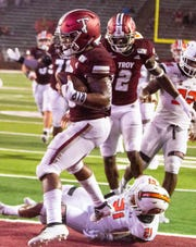 Troy's B.J. Smith crosses over the goal line for the Trojans first touchdown of the second half.