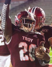 Troy's DK Billingsley celebrates his touchdown during the fourth quarter.
