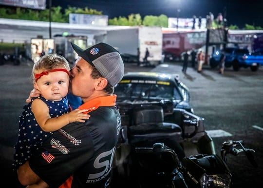 Michael House kisses his daughter Taryn on the cheek after exiting the pro late models race early due to a blown engine at the Nashville Speedway. House drove his father-in-law Sterling Marlin's car after Marlin, who suffers from Parkinson's disease, was unable Saturday, August 31, 2019.