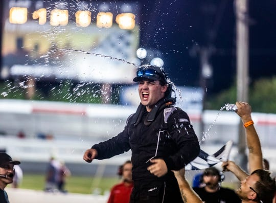 Jackson Boone celebrates after winning the pro late models race at the Nashville Speedway Saturday, August 31, 2019.
