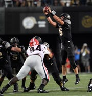 Vanderbilt quarterback Riley Neal (6) reaches for a high snap against Georgia during the first half Saturday.