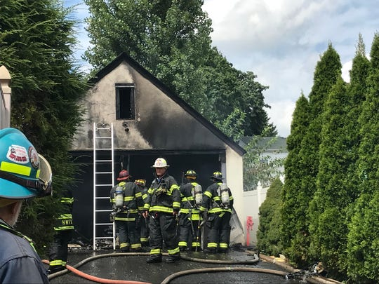 Firefighters at the scene of a garage fire in Hasbrouck Heights on Sept. 1 on Columbus Avenue.