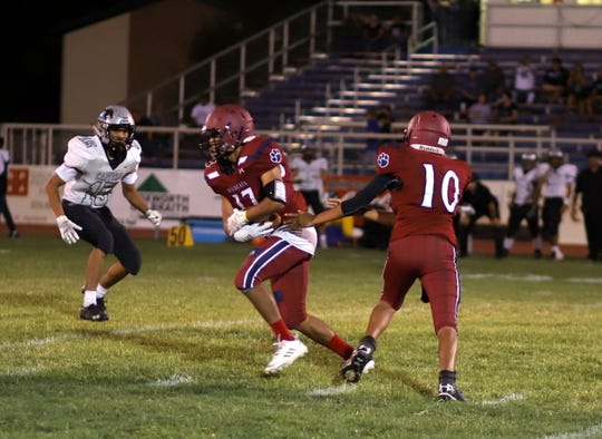 'Cat running back Julio Moran (17) stepped in for an injured Ceazer Chavez and earned tough yards against a stout Capital defense.