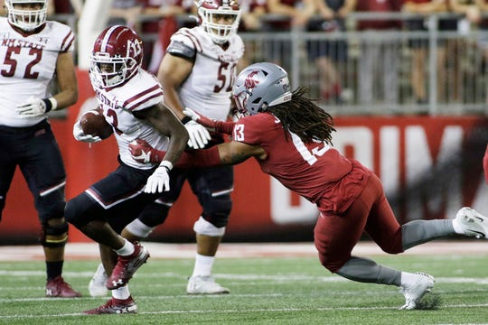 New Mexico State wide receiver Tony Nicholson, left, runs while pursued by Washington State linebacker Jahad Woods during the second half of an NCAA college football game in Pullman, Wash., Saturday, Aug. 31, 2019. Washington State won 58-7. (AP Photo/Young Kwak)