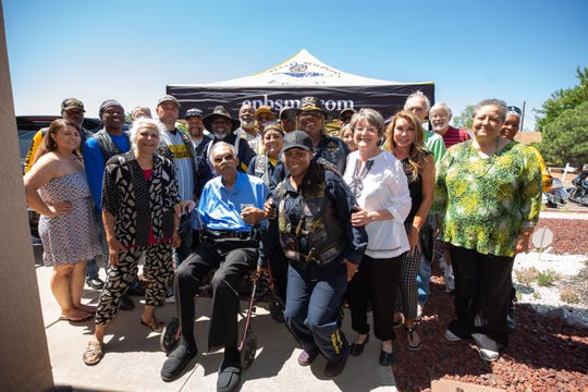 Tuskegee Airman James Clayton Flowers, who turns 103 this year, is surrounded by friends and supporters on Saturday, Aug. 31, 2019, outside of his home in Las Cruces
