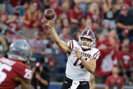 New Mexico State quarterback Josh Adkins (14) throws a pass during the first half of the team's NCAA college football game against Washington State in Pullman, Wash., Saturday, Aug. 31, 2019. (AP Photo/Young Kwak)