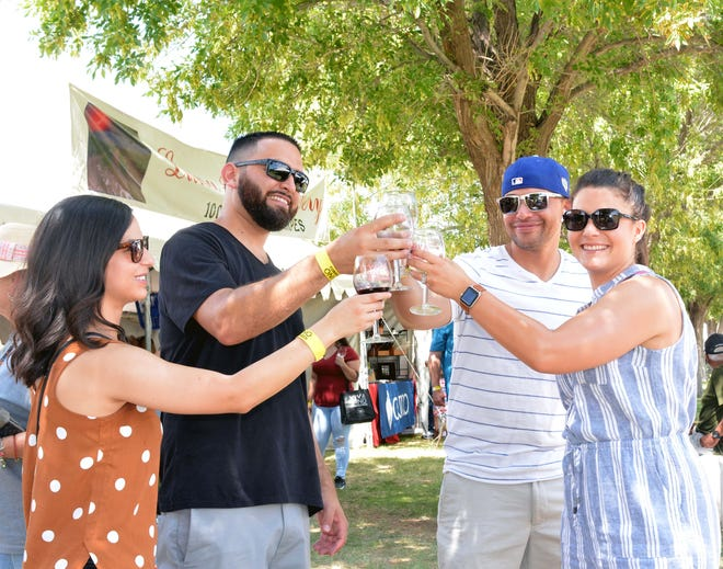From left, Anna Villa, Tony Duran, Samuel Gonzales and Carla Gonzales toast to good friends and good times Sunday, Sept. 1, 2019, at the Harvest Wine Festival at the Southern New Mexico State Fairgrounds.