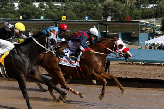 Rusty's Miracle (2) ridden by Noe Garcia Jr. wins the All-American Quarter Horse Derby at the 2019 All-American Derby at the Ruidoso Downs. Miracle was a 17-1 longshot. This is Garcia Jr.'s first win at the All-American Derby.
