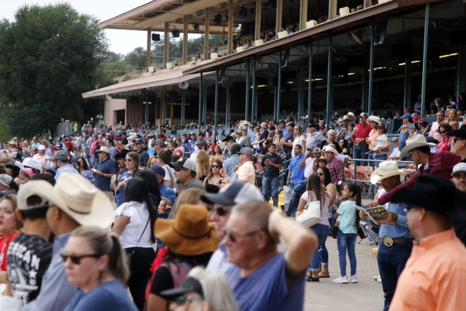 A full crowd watches the Saturday races at the Ruidoso Downs on Aug. 31, 2019. At least for the entire month of May the stands will be completely empty while the Downs reopens for its Memorial Day Weekend races as a safety precaution due to the COVID-19 pandemic.
