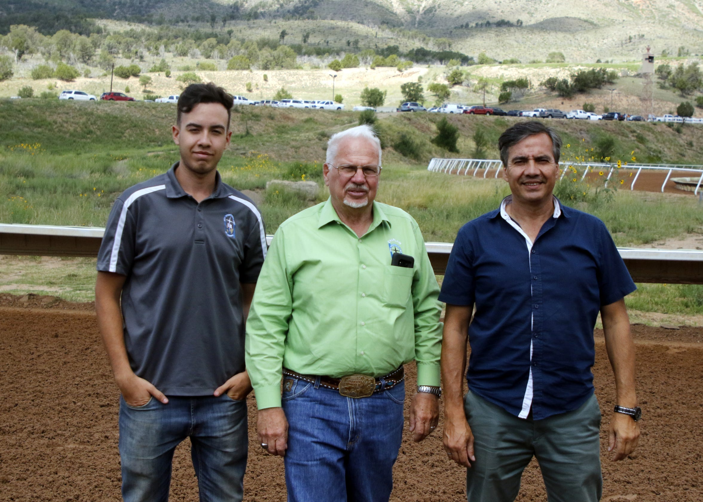 Left to right: Ezekiel Crespo, Chaplain Darrell Winter and Fabian Crespo pose at the Ruidoso Downs Racetrack on Labor Day Weekend. The Crespo's offer Spanish prayers to assist Winter.
