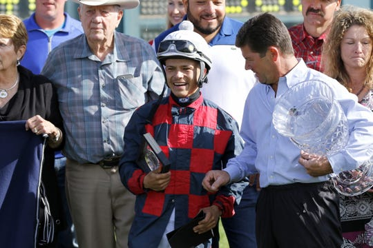 Noe Garcia Jr. receives a plaque from Ruidoso Downs Racetrack GM Jeff True after winning the All-American Quarter Horse Derby at the 2019 All-American Derby at the Ruidoso Downs.This is Garcia Jr.'s first win at the All-American Derby.