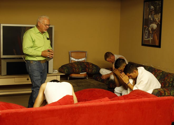 Ruidoso Downs Chaplain Darrell Winter offers prayers to jockeys in the jockey room before their first race on Aug. 31, 2019 at the Ruidoso Downs Racetrack. Winter knows the jockey's don't have time to come to his chapel so he brings the chapel wherever they require it.