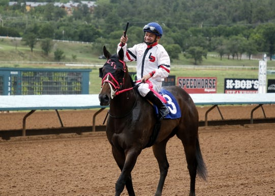 Isaias Enriquez celebrates winning the first race of the day on Aug. 31, 2019 at the Ruidoso Downs Racetrack. Enriquez would win his second and place in his third race of the day.