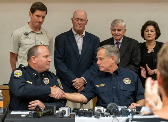 Police Chief Michael Gerke with Texas Gov. Greg Abbott during the press conference at The University of Texas. The death toll rose to seven Sunday after a gunman's rampage that left many more injured following what began as a routine traffic stop in Odessa, police in the West Texas city said.