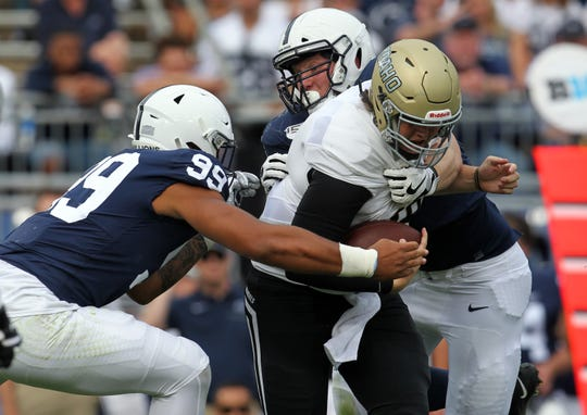 Aug 31, 2019; University Park, PA, USA; Idaho Vandals quarterback Colton Richardson (19) is sacked by Penn State Nittany Lions defensive end Yetur Gross-Matos (99)  and defensive tackle Robert Windsor (54) during the second quarter at Beaver Stadium. Penn State defeated Idaho 79-7. Mandatory Credit: Matthew O'Haren-USA TODAY Sports