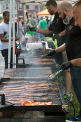 About 600 thick bacon on a stick treats were prepared by Gnaw Jaw Bacon on a Stick and Premium Jerky during the What the Food Trucks event at Penn Park in York.
