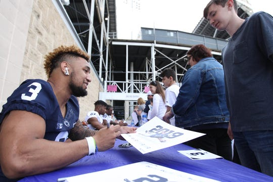 Apr 13, 2019; University Park, PA, USA; Penn State Nittany Lions running back Ricky Slade (3) signs an autograph for a fan prior to the Blue White spring game at Beaver Stadium. Mandatory Credit: Matthew O'Haren-USA TODAY Sports