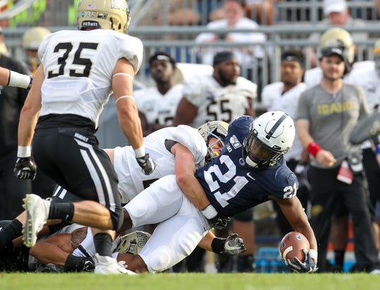 Aug 31, 2019; University Park, PA, USA; Penn State Nittany Lions running back Noah Cain (21) extends his arm holding the ball before being tackled during the fourth quarter against the Idaho Vandals at Beaver Stadium. Penn State defeated Idaho 79-7. Mandatory Credit: Matthew O'Haren-USA TODAY Sports