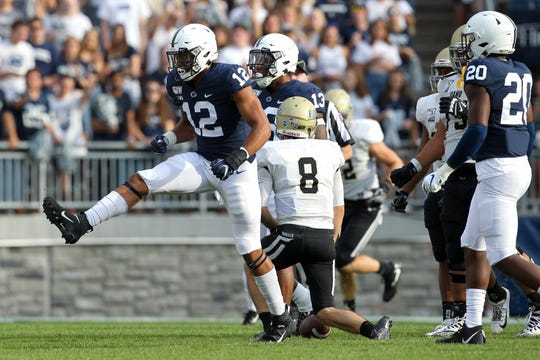 Aug 31, 2019; University Park, PA, USA; Penn State Nittany Lions linebacker Brandon Smith (12) reacts after sacking Idaho Vandals quarterback Mason Petrino (8) during the third quarter at Beaver Stadium. Penn State defeated Idaho 79-7. Mandatory Credit: Matthew O'Haren-USA TODAY Sports