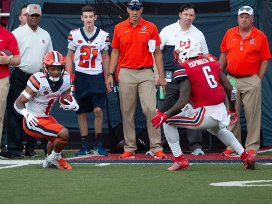 Syracuse wide receiver Sean Riley looks for a way past a Liberty defender during an NCAA college football game in Lynchburg, Virginia. on Saturday, Aug. 31, 2019.