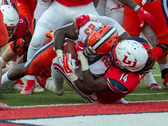 Syracuse running back Abdul Adams scores a touchdown as Liberty linebacker Solomon Ajayi defends during the first half of NCAA college football game in Lynchburg, Virginia, on  Saturday, Aug. 31, 2019.