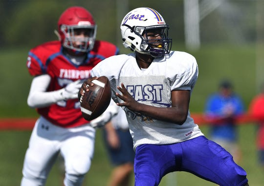 East quarterback Anthony Gilbert looks to pass during a preseason scrimmage at Fairport High School, Saturday, August 31, 2019. Area high school football coaches say the value of scrimmages has decreased in recent years.