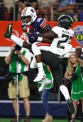 Aug 31, 2019; Arlington, TX, USA; Auburn Tigers receiver Seth Williams (18) catches the game winning touchdown pass against Oregon Ducks cornerback Verone McKinley III (23) late in the fourth quarter at AT&T Stadium. Mandatory Credit: Matthew Emmons-USA TODAY Sports
