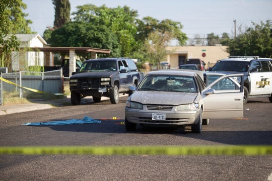 Law enforcement investigate a Toyota passenger car in the 3600 block of Adams Avenue, Odessa, Texas on Sunday, Sept. 1, 2019. The car was involved in a shooting spree that injured or killed several people on Saturday, Aug. 31, 2019.