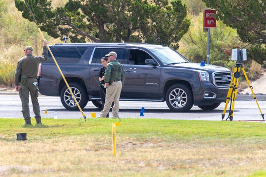 Law enforcement officials investigate an area Sunday at Loop 338 and Highway 191 in Odessa, Texas after a shooting spree left several people injured or killed Saturday, Aug. 31, 2019.