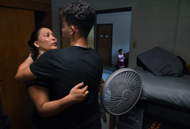 Yesenia Tenorio tearfully hugs her son, Oscar Moreno-Tenorio, on move-in day at James Madison.