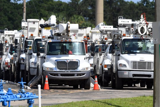 Out of state electric crews began staging in the Piper Aircraft parking lot Sunday, Sept. 1, 2019, at the Vero Beach Regional Airport in preparation for the arrival of Hurricane Dorian.