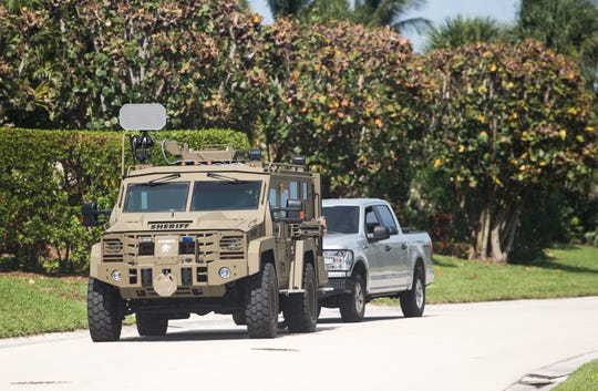 A Martin County Sheriff's Office vehicle drives around Sailfish Point, announcing mandatory evacuation orders over a loudspeaker Sunday, Sept. 1, 2019, as people ready for Hurricane Dorian.