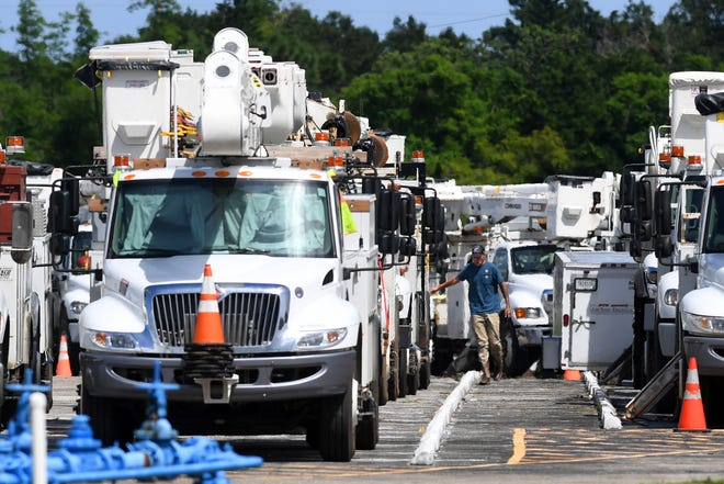 Out of state electric crews begin staging in the Piper Aircraft parking lot  Sunday, Sept. 1, 2019, at the Vero Beach Regional Airport in preparation for the arrival of Hurricane Dorian. The storm, now a Category 5 storm, is expected to bring damaging wind, flooding and coastal erosion to the Treasure Coast.