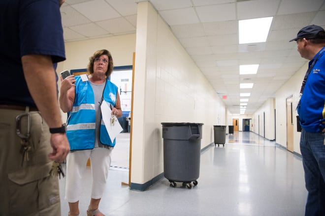 Willoughby Learning Center Principal Laura Husnander helps make final preparations at the new Martin County pet-friendly shelter in the school Sunday, Sept. 1, 2019, as people in the area prepare for the effects from Hurricane Dorian.