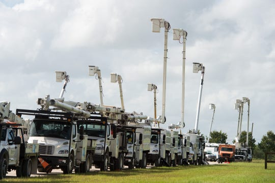 Utility trucks from around the country stage at the St. Lucie County Fairgrounds on Sunday, Sept. 1, 2019, before the effects of Hurricane Dorian are predicted to impact the region as a tropical storm.