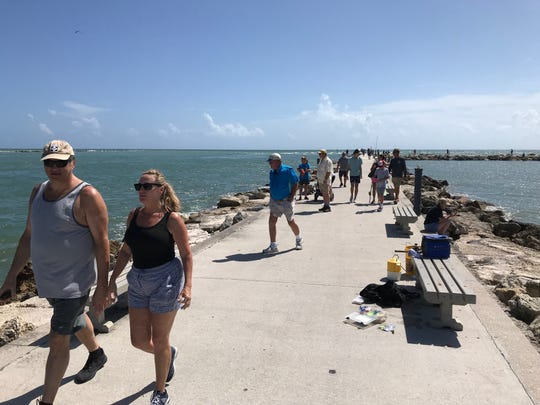 Plenty of people on the South Jetty in Fort Pierce Sunday