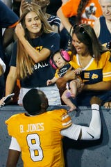 UTEP's Quarterback Brandon Jones goes to give his niece a kiss after their win against Houston Baptist Saturday, Aug. 31, in the season opener at the Sun Bowl in El Paso.
