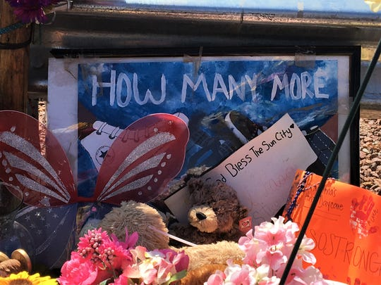 """How many more"" is asked on a sign at the El Paso Walmart shooting memorial on Sunday, Sept. 1, 2019."