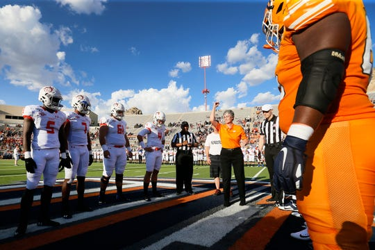 UTEP President Heather Wilson does the coin toss for the game against Houston Baptist Saturday, Aug. 31, in the season opener at the Sun Bowl in El Paso.