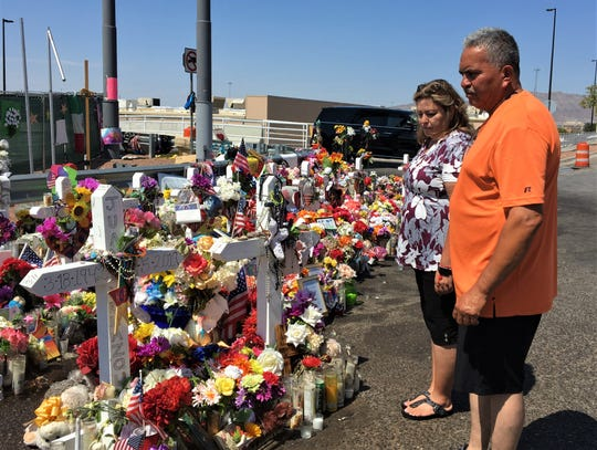 Grace Bueno and Albert Artalejo, both of Granbury, Texas, visit the El Paso Walmart shooting memorial on Sunday,  Sept. 1, 2019.