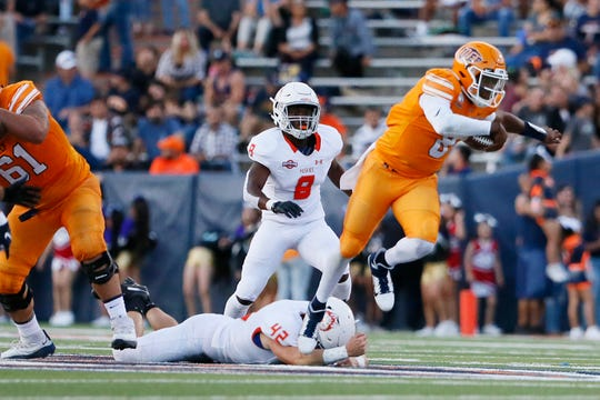 UTEP's Quarterback Brandon Jones runs the ball during the game against Houston Baptist Saturday, Aug. 31, in the season opener at the Sun Bowl in El Paso.