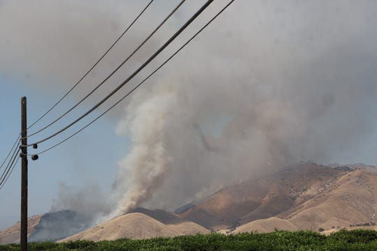 CAL Fire crews work to contain a 680-acre wildfire east of Woodlake, near Dry Creek Preserve.