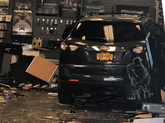 A car crashed through the front window of GameStop in Pelham Manor on Sunday, Sept. 1, 2019.