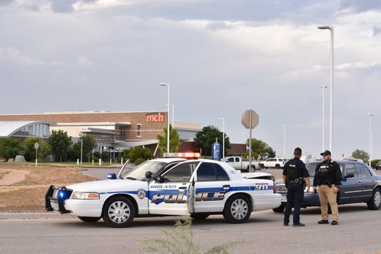 Scene outside the Cinergy movie theater in Odessa, Texas, where a gunman was killed in a shootout with police, authorities say.